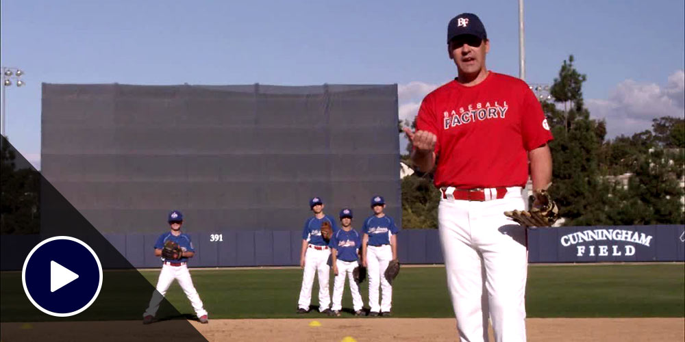 coach and players in outfield