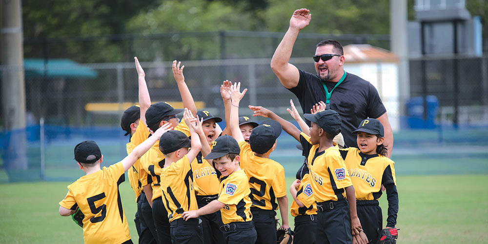 bb players and coach high fiving