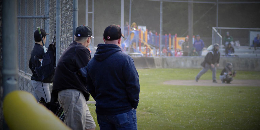 coaches watching a game