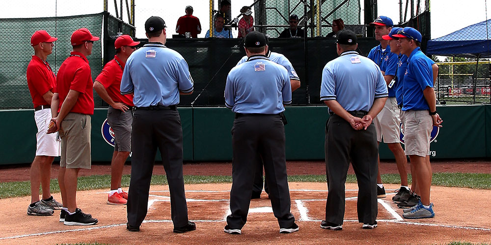 managers and umpires at a plate meeting