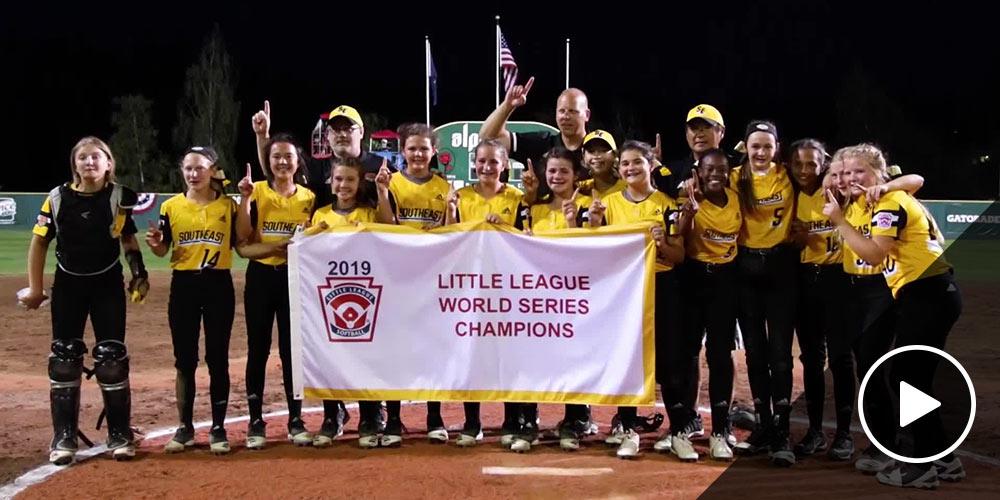 southeast team holding banner