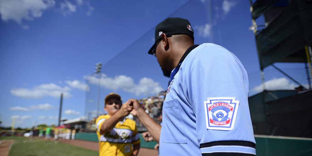 umpire fist bumping player