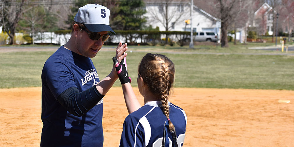 coach & player high fiving